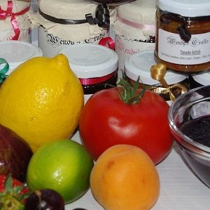 Fresh lemon tomato lime and apricot and Jam in Jars