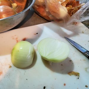 Cutting brown onions for Beetroot Relish